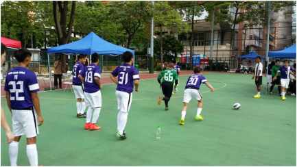 The Hong Kong representative team warms up on the side of the mini pitches.